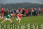 > Chris Spiers  Rathmore is challenged by Darragh O'Doherty Legion in the Senior club championship in Rathmore on Saturday night