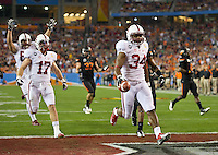 STANFORD, CA - January 2, 2012: Stanford running back Jeremy Stewart (34) scores a touchdown against Oklahoma State at the Fiesta Bowl at University of Phoenix Stadium in Phoenix, AZ. Final score Oklahoma State wins 41-38.