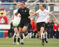 Abby Wambach (blue) of the Washington Freedom pushes away from Keely Dowling  of Sky Blue F.C. during a WPS pre season match at Maryland Soccerplex,in Boyd's, Maryland on March 14 2009. Sky Blue won the match 1-0