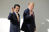 U.S. President Donald Trump and Japan Prime Minister Shinzo Abe walk together to their joint press conference in the East Room at the White House on February 10, 2017 in Washington, DC. Trump and Abe are expected to discuss many issues, including trade and security ties and will hold a joint press confrence later in the day.<br /> Credit: Chip Somodevilla / Pool via CNP