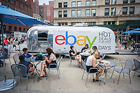 "The online market eBay, promotes their ""Hot Deals for Hot Days"" promotion in Flatiron Plaza in New York on Tuesday, July 7, 2015. The branding promotion enables consumers to buy sunglasses at discounts corresponding to the high temperature of the day. Today's 83 F temperature gave buyers 83 percent off their purchase. (© Richard B. Levine)"