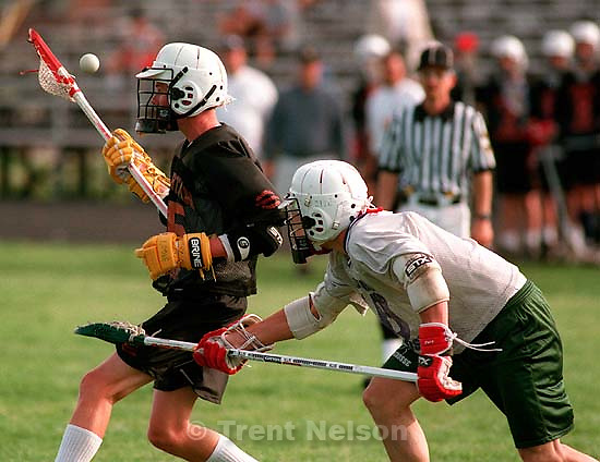 Murray's Jadee Talbot (left) bobbles the ball as Utah County Warriors' Jared Jaynes as they play for the Division II lacrosse championship at Murray High School.<br />