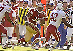 San Francisco 49ers running back Kevan Barlow (32) runs along sidelines to out pace defenders on Sunday, October 27, 2002, in San Francisco, California. The 49ers defeated the Cardinals 38-28.