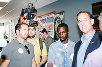 Former Pennsylvania senator and Republican presidential candidate Rick Santorum greets people after a town hall event at the Concord office of New England College in Concord, New Hampshire.