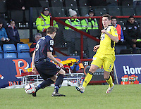 Kenny McLean beats Steven Saunders in the Ross County v St Mirren Scottish Professional Football League match played at the Global Energy Stadium, Dingwall on 17.1.15.
