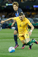 October 11, 2016: GENKI HARAGUCHI (8) of Japan fouls TOMI JURIC (9) of Australia in the penalty box during a 3rd round Group B World Cup 2018 qualification match between Australia and Japan at the Docklands Stadium in Melbourne, Australia. Photo Sydney Low Please visit zumapress.com for editorial licensing. *This image is NOT FOR SALE via this web site.