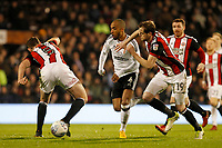 Denis Odoi of Fulham FC takes on Jack O'Connell of Sheffield United during the Sky Bet Championship match between Fulham and Sheff United at Craven Cottage, London, England on 6 March 2018. Photo by Carlton Myrie.