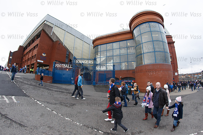 Fans arrive for the match at Ibrox Stadium