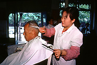 September, 1985. Shaanxi Province, China. Hairdressing salon in Yan'an.