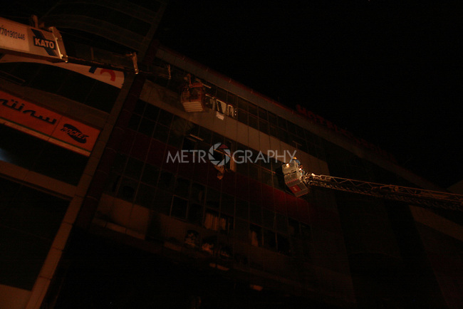 SULAYMANIYAH, IRAQ: Fireman use a ladder to rescue residents from the Soma Hotel on July 15, 2010...At least 41 people, including several foreign nationals, died in a hotel fire in the city of Sulaymaniyah in northern Iraq.  Another 23 people were injured in the fire on Thursday at the Soma Hotel in the central area of the city.<br /> <br /> Photo by Rawsht Twana