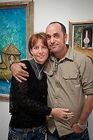 Cuban Artist Eduardo Miguel Abela Torras poses with his wife, Ioanna, in front of his works at The von Liebig Art Center, after the ribbon cutting ceremony to launch the 'Cuba on My Mind' exhibit, March 10, 2011. Photo by Debi Pittman Wilkey