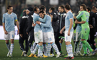 Calcio, semifinale di ritorno di Coppa Italia: Lazio vs Juventus. Roma, stadio Olimpico, 29 gennaio 2013..Lazio forward Sergio Floccari, center, is congratulated by teammates at the end of the Italy Cup football semifinal return leg match between Lazio and Juventus at Rome's Olympic stadium, 29 January 2013. Lazio won 2-1 to reach the final match scheduled on May..UPDATE IMAGES PRESS/Riccardo De Luca