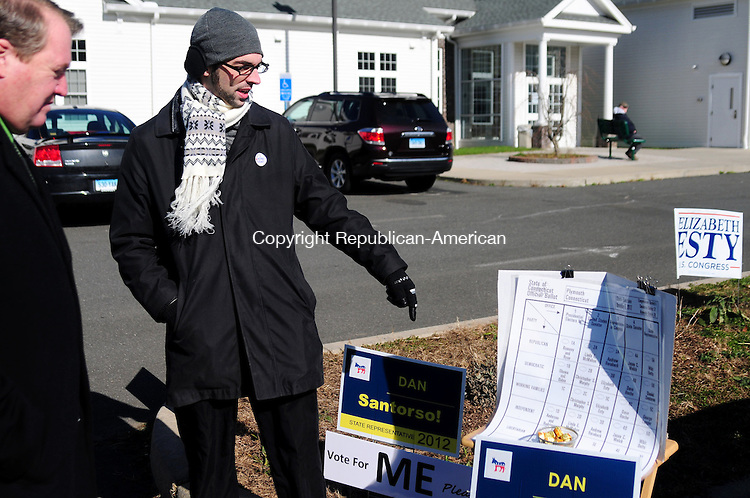 PLYMOUTH, CT, 06 NOV 12-11062AJ01- Dan Santorso, a Democratic candidate for the 78th House District shows Dave Roche a Democratic candidate for the 31st Senate District his signs outside The Lyceum in Plymouth Tuesday morning. Alec Johnson/ Republican-American
