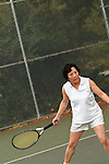 Asian woman playing tennis