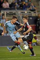 Matt Besler (5) defender Sporting KC fights for the ball with Dejan Jakovic (5) defender D.C Utd .Sporting Kansas City defeated D.C Utd 1-0 at Sporting Park, Kansas City, Kansas.