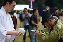 November 3, 2011, Tokyo, Japan - A male musketeer dressed in traditional attire receives ritual rice-wine at the end of Martial Arts demonstration held at Meiji shrine to celebrate Japan's National Culture Day. (Photo by Bruce Meyer-Kenny/AFLO) [3692]
