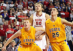 VERMILLION, SD - FEBRUARY 9: Trevor Gruis #50 from the University of South Dakota eyes the basket for a rebound with Tony Fiegen #34 and Chad White #25 from South Dakota State in the second half of their game Thursday night at the DaktaDome in Vermillion, SD. (Photo by Dave Eggen/Inertia)