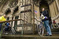 Cyclists exit the Cathedral of St John the Divine in New York City, USA, after the annual blessing of the bicycles, 22 April 2006. Several dozens cyclists, professional and recreational, and a few roller skaters attended the ceremony during which prayers were said for those who died in cycling accidents this year and to ask for a safe season.<br />