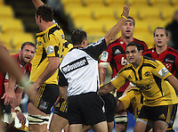 Referee Chris Pollock awards a penalty to the Hurricanes just before halftime as Piri Weepu looks on. Super 15 rugby match - Crusaders v Hurricanes at Westpac Stadium, Wellington, New Zealand on Saturday, 18 June 2011. Photo: Dave Lintott / lintottphoto.co.nz