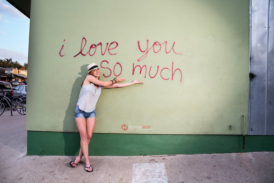 "Every day there are thousands of smiling photos, kissing photos, and goofy photos taken in front of the ""I love you so much"" mural."