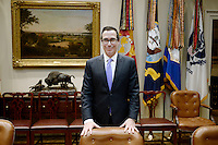 United States Secretary of the Treasury Steve Mnuchin stands behind his chair in the Roosevelt Room of the White House in Washington, DC prior to a meeting with US President Donald J. Trump to discuss the Federal budget on February 22, 2017 in Washington, DC. Photo Credit: Olivier Douliery/CNP/AdMedia
