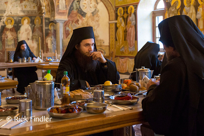 Mount Athos - The Holy Mountain.<br /> A monk in deep thought as he eats in silence in the refectory of Pantokratoros. <br /> <br /> Photographer: Rick Findler