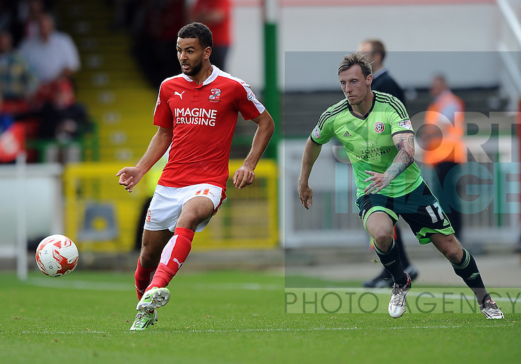 Kevin Stewart of Swindon Town is challenged by Martyn Woolford of Sheffield United<br /> - English League One - Swindon Town vs Sheffield Utd - County Ground Stadium - Swindon - England - 29th August 2015