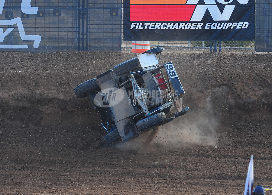 Dec. 11, 2011; Chandler, AZ, USA;  LOORRS pro lite driver Kyle LeDuc (99) crashes during the Lucas Oil Challenge Cup at Firebird International Raceway. Mandatory Credit: Mark J. Rebilas-