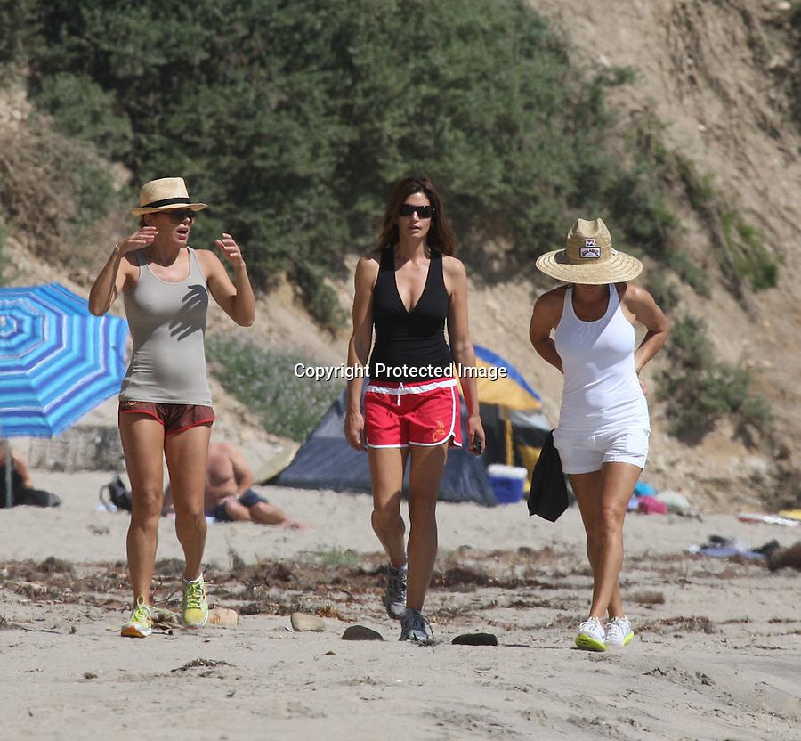 3-28-09.Exclusive.Cindy Crawford walking on the beach in Malibu with some friends...AbilityFilms@yahoo.ocm.805-427-3519.www.AbilityFilms.com