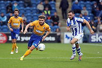 Alex MacDonald of Mansfield Town runs past Drey Wright of Colchester United during Colchester United vs Mansfield Town, Sky Bet EFL League 2 Football at the Weston Homes Community Stadium on 7th October 2017