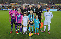 Team captains Jermain Defoe for Sunderland and Leon Britton for Swansea, join match officials, referee Craig Pawson and children mascots during the Premier League match between Swansea City and Sunderland at The Liberty Stadium, Swansea, Wales, UK. Saturday 10 December 2016
