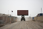 Mcc0053988 . Daily Telegraph<br /> <br /> DT News<br /> <br /> A heavy vehicle transports a freight container in Camp Bastion .<br /> The British force are due to pull out by the end of 2014 and are already in drawdown mode , 3400 vehicles and pieces of major equipment are having to be transported out of Afghanistan .<br /> <br /> Helmand 1 April 2014