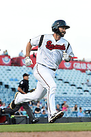Nashville Sounds catcher Matt Pagnozzi (10) runs to first during a game against the Omaha Storm Chasers on May 19, 2014 at Herschel Greer Stadium in Nashville, Tennessee.  Nashville defeated Omaha 5-4.  (Mike Janes/Four Seam Images)