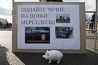 "Moscow, Russia, 22/10/2011..A poster reading ""Help give Chechnya a new Mercedes"" at a Russian nationalist protest """"Stop Feeding The Caucasus"" against the alleged over-subsidisation of the North Caucasus region, including Chechnya, by the central Russian government. The campaign has been organised by the Russian Public Movement and the Russian Civil Union, who have joined under the common banner of The Russian Platform."