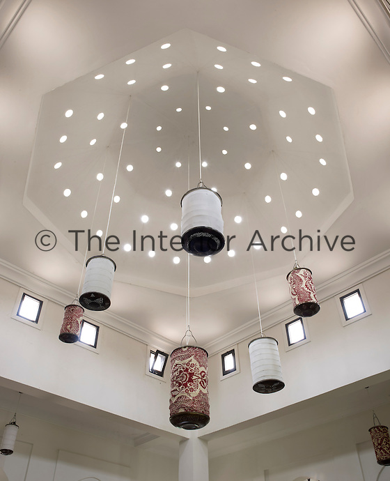 A collection of paper lanterns is suspended from the cupola in the great room
