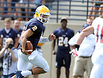 SIOUX FALLS, SD - SEPTEMBER 7:  Trey Heid #2 from Augustana looks at defender Garrett Shelley #18 from Minnesota State University Moorhead en route to a touchdown in the first quarter of their game Saturday at Augustana. (Photo by Dave Eggen/Inertia)