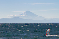 A wind surfer in front of Mount Fuji. Muira, Kanagawa, Japan. Thursday December 29th 2016
