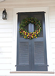 "Door Christmas wreath Colonial Williamsburg Virginia historic district 1699 to 1780 which made colonial Virgnia's Capital, for most of the 18th century Williamsburg was the center of government education and culture in Colony of Virginia, George Washington, Thomas Jefferson, Patrick Henry, James Monroe, James Madison, George Wythe, Peyton Randolph, and others molded democracy in the Commonwealth of Virginia and the United States, Motto of Colonial Williamsburg is ""The furture may learn from the past,"""