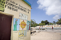 Djibouti. Djibouti province. Arta. Association du Comité des Jeux Estivals d'Arta( ACOJEA). Mural painting. Various drawings and situations on how to be infected by the HIV Aids disease. You can get HIV Aids by blood contact or transfusion, sex, mother to child transmission, cuting yourself with a blood infected blade, knife, csissors. Three black muslim men are walking on the concrete road. The Global Fund through the djiboutian Ministry of Health supports the programm with an Aids grant (financial aid).  © 2006 Didier Ruef