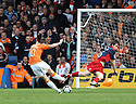 David McGurk of York City tries to block Tom Craddock of Luton's shot during the Blue Square Premier play-off semi-final 2nd leg  match between Luton Town and York City at Kenilworth Road, Luton on Monday 3rd May, 2010..© Kevin Coleman 2010 ..