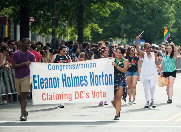 UNITED STATES - JUNE 13 - Del. Eleanor Holmes Norton, D-D.C., right, walks down P Street NW during the annual annual Capital Pride Parade in Washington on Saturday, June 13, 2015. (Photo By Bill Clark/CQ Roll Call)