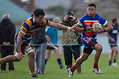 Alex Samoa makes a break past Theodore Solipo. Counties Manukau Premier Club Rugby game between Patumahoe and Ardmore Marist, played at Patumahoe on Saturday July 9th 2016.<br /> Ardmore Marist won the game 33 - 24 after leading 18 - 12 at halftime. Photo by Richard Spranger.