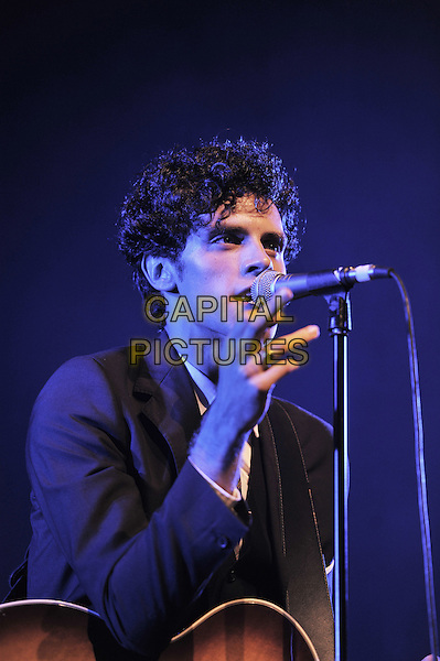 Charlie Fink.Noah and the Whale performing live in concert at Brixton Academy, London, England..26th October 2011.stage concert gig performance in on half length suit guitar black suit singing.CAP/MAR.© Martin Harris/Capital Pictures.