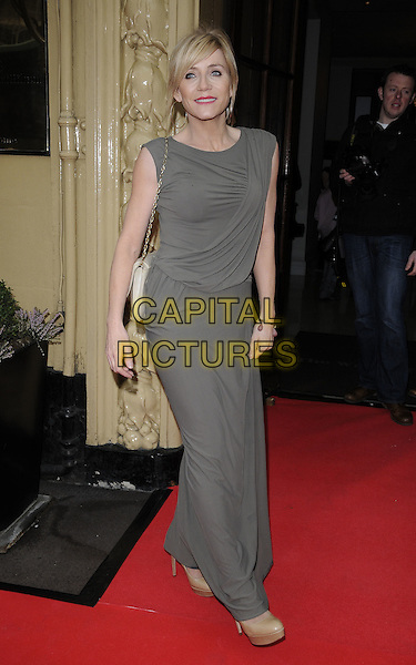MICHELLE COLLINS .At the Tesco Magazine Mum Of The Year 2011 Awards, The Waldorf Hilton Hotel, London, England, UK, .February 27th, 2011..full length grey gray dress long maxi sleeveless bag cream white .CAP/CAN.©Can Nguyen/Capital Pictures.