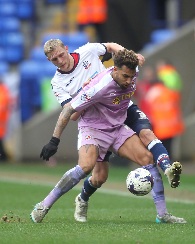 Bolton Wanderers Dean Moxey battles with  Reading's Daniel Williams<br />