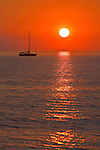 Sailboat at sunset off Lido Key, Sarasota, FL.