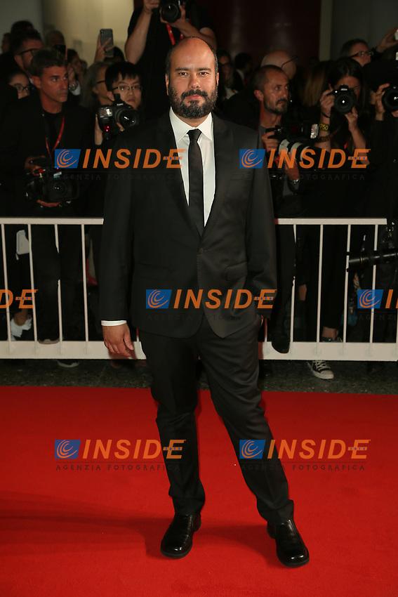 """VENICE, ITALY - SEPTEMBER 06: Ciro Guerra walks the red carpet ahead of the """"Waiting For The Barbarians"""" screening during the 76th Venice Film Festival at Sala Grande on September 06, 2019 in Venice, Italy. (Photo by Mark Cape/Insidefoto)<br /> Venezia 06/09/2019"""