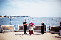 Bishop Arthur Kennedy of the Roman Catholic Archdiocese of Boston leads the Blessing of the Fleet near Gloucester Harbor during St. Peter's Fiesta in Gloucester, Massachusetts, USA.