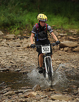 NWA Democrat-Gazette/ANDY SHUPE<br /> Connor Phillips of Bentonville rides across Lee Creek Saturday, Sept. 19, 2015, during the Northwest Arkansas Mountain Bike Championships at Devil's Den State park.