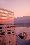 Vancouver, Cruise ship arriving at Canada Place, downtown Vancouver, British Columbia, Canada, dusk,.